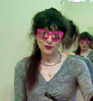 authorphoto3pinkglasses